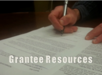 text Grantee Resources with hand signing document